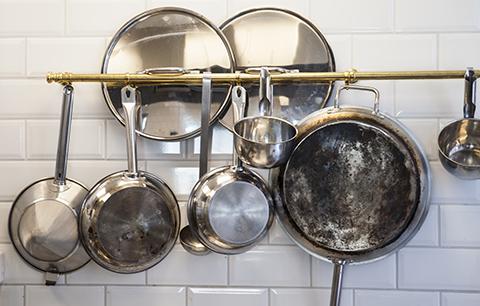 Kitchen utensils hanging in kitchen nng8 bys